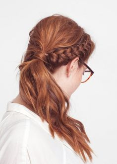 French braid your bangs into a pony to get this look.