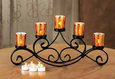 Beautiful Iron Candle Holder - perfect for a dining table centerpiece or the back of a buffet. Harvest Decorations, Outdoor Christmas Decorations, Light Decorations, Seasonal Decor, Fall Decor, Wrought Iron Candle Holders, Candle Holder Decor, Unique Candles, Floating Candles