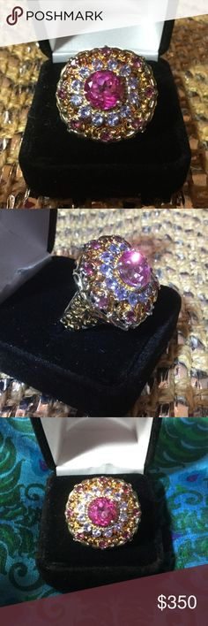 Genuine Pink Topaz and Tanzanite Ring ! This eye popping ring of The Crown Jewels is like wearing a constellation of the universe captured upon your finger !  This is probably a one of a kind,  set in a heavy Sterling silver.  Very intricate detailing.  If this was set in gold it would be thousands of dollars. Estate Jewelry Rings
