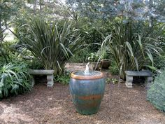 Bold plantings of New Zealand flax (Phormium) and aloes frame a small gathering space in a Santa Monica garden by landscape architect Joseph Marek. Photograph by Joseph Marek Hanging Plants, Horticulture, Flax Plant, Garden Design, Plants, Container Plants, Landscape Design, Chinese Garden, Landscape
