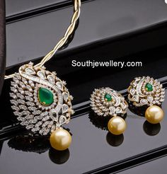 Dazzling diamond pendant set studded with rose cut diamonds and emeralds in yellow gold and south sea pearl drops at the bottom. Related PostsDiamond Pendant and Jhumkas SetRose Cut Diamond Pendant SetDiamond PendantsDiamond Long EarringsDiamond Pendant SetSimple Diamond Pendant Set