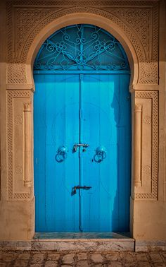Blue doors, commonly found in the Mediterranean and North Africa, are thought to repel evil. Door Entryway, Entry Doors, Entrance, Colour Architecture, Door Paint Colors, When One Door Closes, Painted Front Doors, Knobs And Knockers, Cool Doors