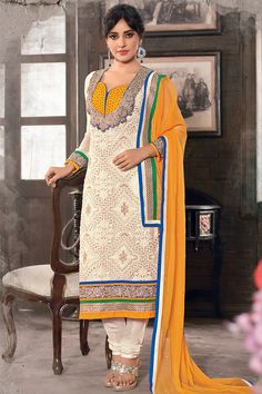 Eye Catchy Yellow and blue combination neck style in Creamy colour georgette material.