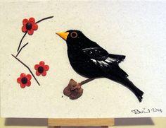 Quilled blackbird with plum blossom