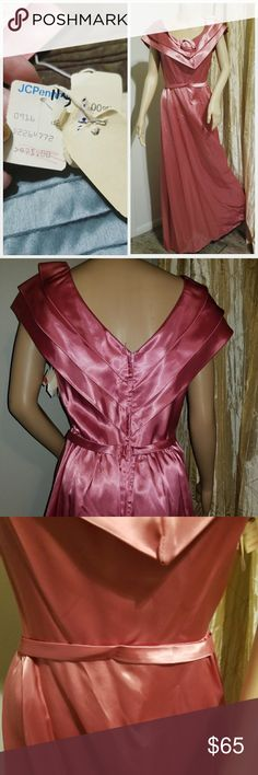 Authentic jcpenny 1950s gown Authentic 1950s. Gown. Still has fragments for original jcpenny tag. Satin rose with matching satin fabric. Zipper up the back. The only flaws.with the dress are a grey scuff and am a couple snagged wholes at bottom they are pictured Vintage Dresses Maxi