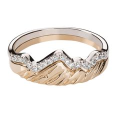 Take a part of the majestic Tetons with you as you travel the world. Featuring a combination of 14 Karat polished yellow gold, white gold, and diamonds, each ring contains a bit of the inspirational b