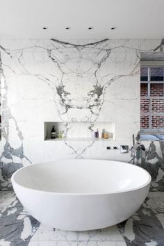 marble bathroom and tub....look at the marble design. Intentional? Looks like a…