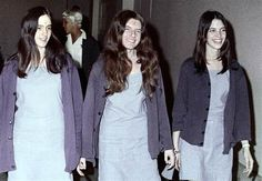 Susan Atkins, Patricia Krenwinkle and Leslie Van Houten, from left to right, are shown en route to court in Los Angeles, Ca., August 1970. The three women, displaying the symbol X on their foreheads as followers of the Manson cult family, were involved in one of the most notorious mass murders in California history:Tate-LaBianca murders.
