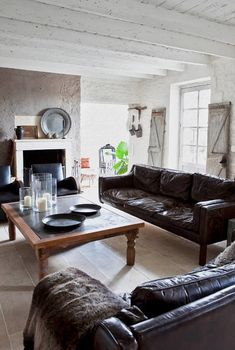 comfy couch. fabulous painted beams.