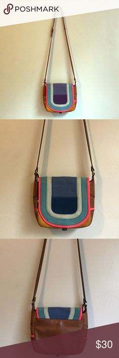 Fossil Lennox Small Saddle Bag Crossbody Fossil Lennox Small Saddle Bag - Bright Stripe  Cute & colorful Fossil crossbody bag! Made of genuine leather!  There are a few minor issues with the bag. See the last two photos. There is one small circular stain on the inside crease flap that is not easily visible, and some glue stains that came on the bag from the production facility. And a couple of small scratches. Other than those issues, the bag is in great condition and should provide you…