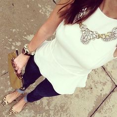 Great combo of simple cream top in a cute style with the peplum and then a statement necklace.