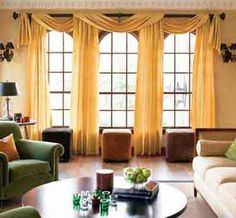 window treatment. Long, artfully arranged drapes and height and drama to any room. For the most impact, raise the curtain rod at least a few inches above the window- it will add height and dimension to the look.