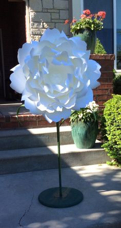 Giant paper flowers on stems free standing
