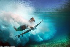 These stunning underwater snaps of surfers carving up the waves will take your breath away