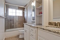 Extravagant White Vanity Bathroom With White Woods Materials And Target Shelves Also Drawers Storage With Grey Granite On Tops Single Sink Ideas As Well As White Bathtubs And Toilet On Brown Ceramic Tiles Floors In Small Modern Bathroom Remodel Pictures