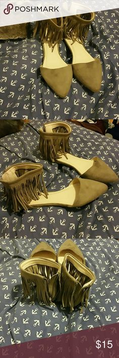 Suede flats Fringe sueded Flats color tan .. there are some scratches in the inside of the shoe but you can't tell. Shoes Flats & Loafers