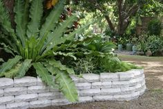 Retaining walls can help define flower beds, create visual areas of interest and, most importantly, prevent soil erosion.  Want a step-by-step tutorial on how to build a DIY version? Check out A Crafted Passion.