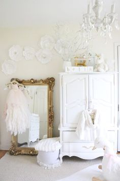 Gorgeous White Dreamy Baby Girl Nursery - adding different texture can give a white nursery warmth!