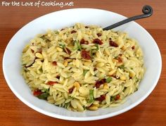 ORZO WITH SUN-DRIED TOMATO, PINE NUTS, AND BASIL  3/4 cup of uncooked orzo, prepared per instructions in salted water 1 tsp olive oil 3 tbsp sun-dried tomatoes, chopped 2 cloves of garlic, minced 3 tbsp toasted pine nuts Sea salt and freshly cracked pepper, to taste. 1 tbsp white balsamic vinegar 3 tbsp fresh basil, chopped