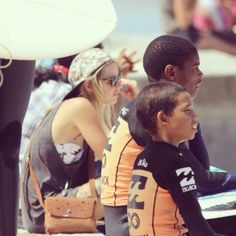Tarryn with the outreach kids watching the WP longboard trials
