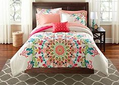 The reversible comforter allows you to change the look of your room with a flip of a comforter. The comforter features a large scale offset medalli...