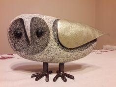 Own, birds sculpture made of stone (gray granite) and steel