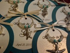 http://www.etsy.com/listing/128298944/50-custom-beach-themed-wine-charm-favors