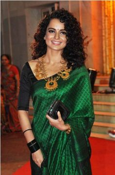 """Kangana Ranaut in Traditional Saree at Mohit Suri's Wedding. This seasons color """"Emerald"""" Saree in banarsi fabric while the designer saree blouse is plain black in satin/silk fabric. A party wear yet casual saree for any small occasion to normal wear. Indian Attire, Indian Wear, Indian Outfits, Beauty And Fashion, Asian Fashion, Sari Bluse, Indische Sarees, Lehenga, Anarkali"""