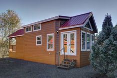 A cabin-style park model home with a bright and functional layout! Currently available for sale in Salem, Oregon!