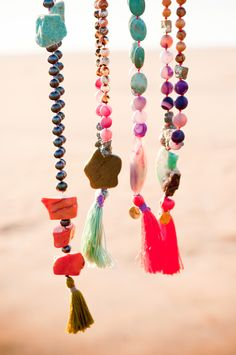 I like the mixed gems with the tassels