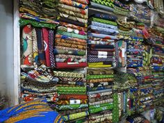 Fabrics from Kampala, Uganda. I could wander for hours in a fabric store. Make it African fabric, I'd be there forever.