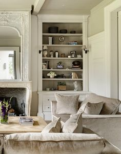 Bespoke Bookcase and panelling, Antique Belgian fireplace -Minnie Peters www.minniepeters.com