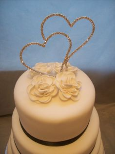 My 4 tier with full bloom roses and diamante heart topper....$750.