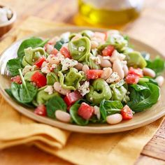 Spinach Tortellini with Beans and Feta - For a dinner with pizzazz, toss cheese-filled spinach tortellini (purchased from the supermarket) with garlic-and-herb feta cheese, tomatoes, spinach, and white beans. | BHG