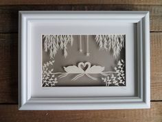 Forever features two swans that have been hand cut, from cream hammered paper, using a scalpel. The design has been hand drawn and cut out by