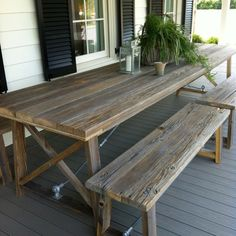 Picnic table on front porch. Love the detached benches.