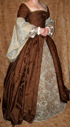 Venefica Corsetry & Costume Gallery of previous works: Heavily Beaded Tudor Gown. She has great looks!