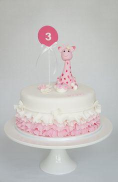 Pink giraffe cake, white and pink ruffles. Birthday cake, vanilla sponge marble fondant cake