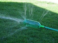 This definitely looks like summer fun to us! Make little holes in an empty plastic bottle and attach it to a garden hose.