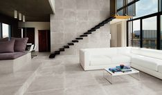 Petra: a faithful reproduction of large slabs of Pietra di Borgogna with original, unique traces left by the passage of time.