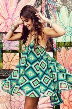 Great print and especially the colors. Looks like a fun dress. I'd wear it with capri leggings maybe since I'm not a youngster.