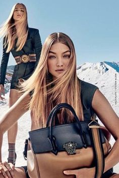 Gigi Hadid wearing Versace Tailored Vest and Versace Colorblocked Leather Bag