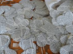 The flower girl is using these instead of flower petals...and they'd also make a great table decoration if they were sprinkled sparingly enough. Wouldn't it be cute to use script copies of the first play we worked on together?