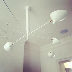 SERGE MOUILLE SIX ARM CEILING LAMP             http://www.zoralighting.com/designer/serge-mouille/serge-mouille-six-arm-ceilimg-lamp
