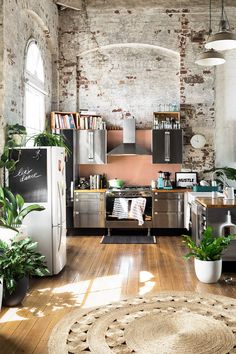 Kitchen Inspiration: I love the stainless steel appliances and the brick. This makes a real statement. See it here:https://i.pinimg.com/originals/86/09/8b/86098b823abcf67d5b9218ad20d32bf3.jpg
