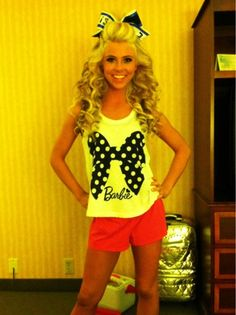 in love with her hair for cheer and her shirt cause its BARBIEEEEEE :))