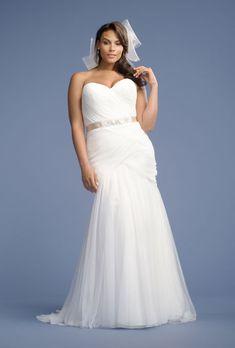 Brides.com: Designer Plus-Size Wedding Dresses We Love Style 3148, beaded embroidery on Alençon lace, $1,350, Mori Lee  See more Mori Lee wedding dresses.Photo: Courtesy of Mori Lee