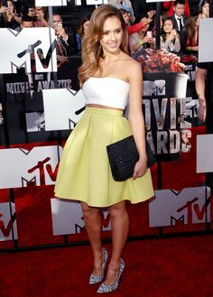 Jessica Alba is on trend in a crop top and full mini skirt // #Fashion #Style