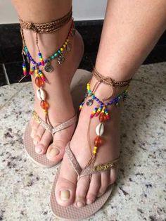 http://produto.mercadolivre.com.br/MLB-829935570-sandalia-pes-descalcos-mandala-barefoot-com-buzio-par-_JM