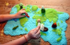 World map felted play scape- though I think I would make it much bigger in scope so it could accommodate animals, boats, etc.